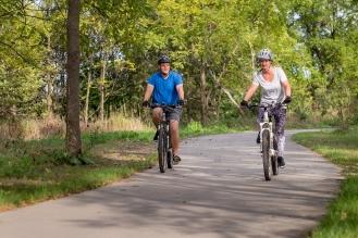 Jewel and her husband bicycle exercise