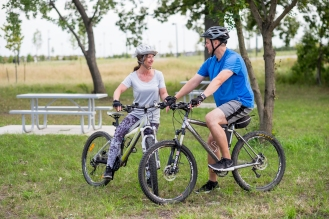 Jewel and her husband bicycle workout