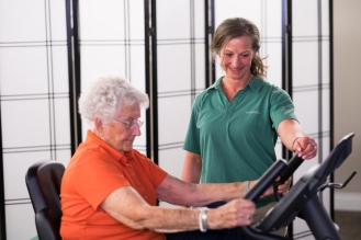 Jewel provides exercise instruction to client