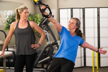 Jewel provides fitness instruction to client