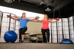 personal training using cable bands fitness workout with client