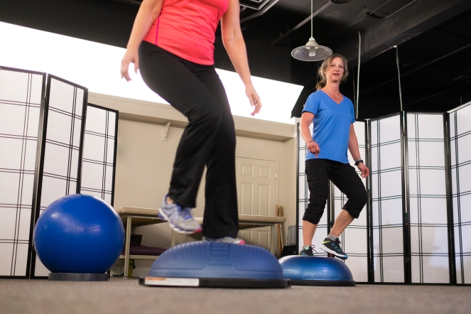 Balance training on Bosu for core strength and endurance