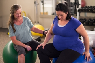 Jewel provides prenatal exercise to client